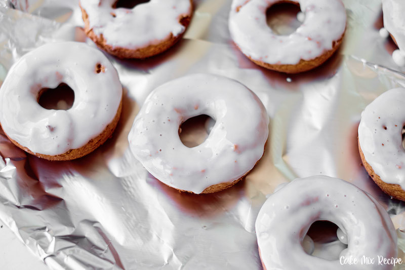 Donuts being glazed.