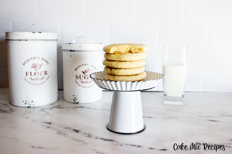 another look at the finished soft cake mix sugar cookies ready to eat with a bite out of the top cookie.