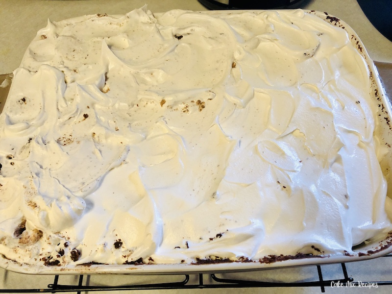 Cake topped with cool whip after cooled.