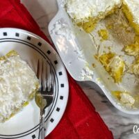 Featured image showing the finished pineapple coconut poke cake ready to eat.
