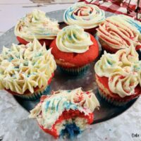 Featured image showing the finished layered red white and blue cupcakes ready to eat.