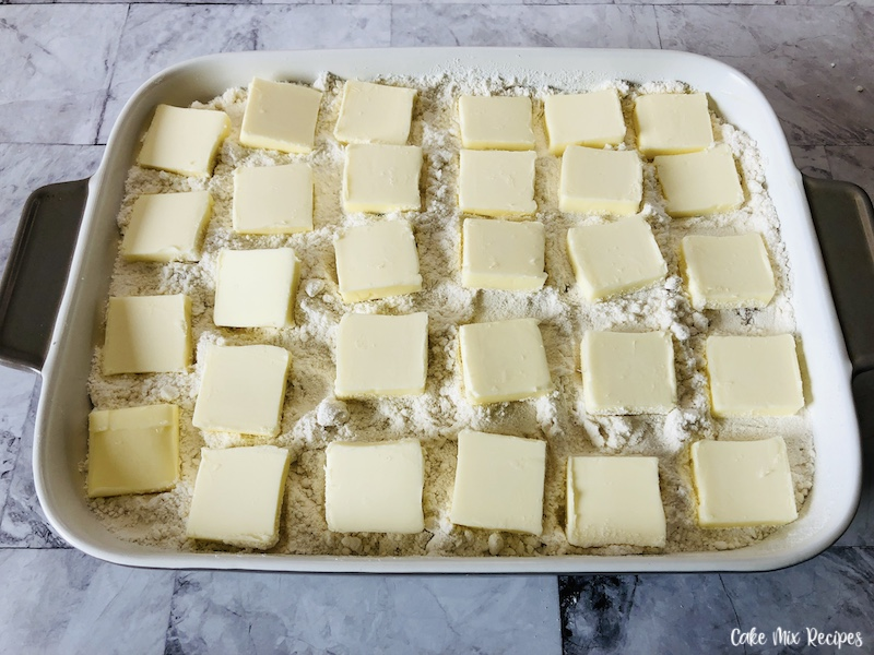 Butter sliced and evenly layered on top of the cake mix.