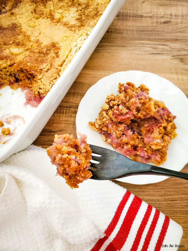 A forkful of the finished pineapple cherry dump cake ready toe at.