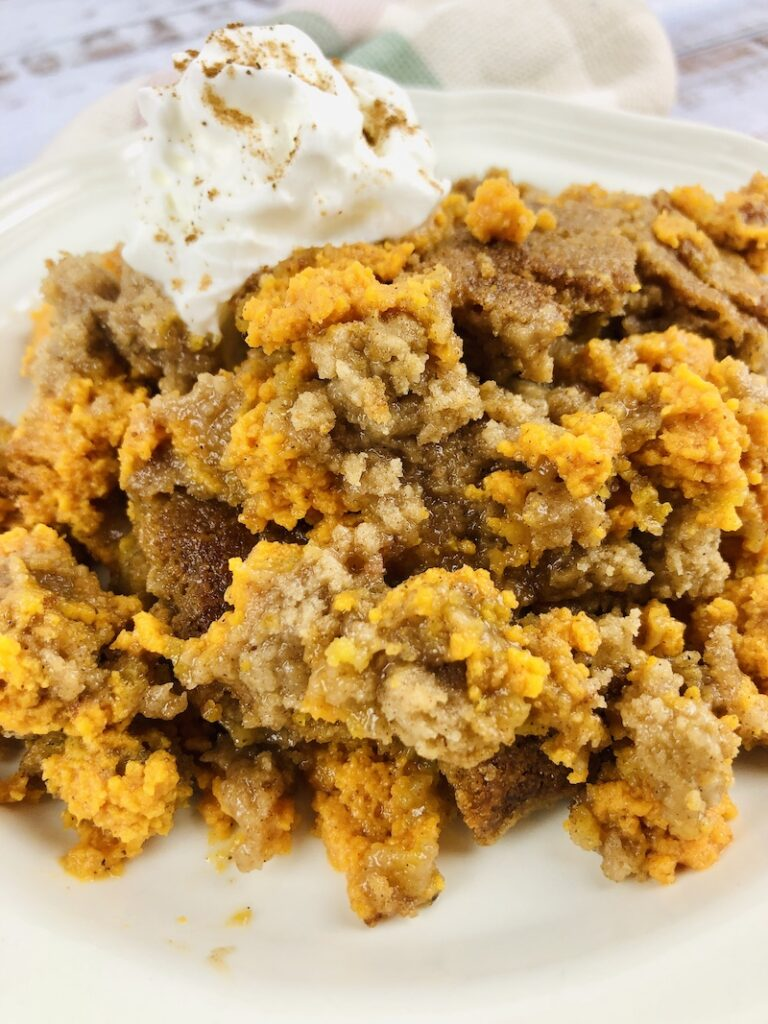 A close up view of the finished pumpkin spice dump cake ready to eat.