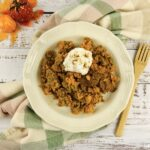 Featured image showing the finished pumpkin spice dump cake ready to eat.