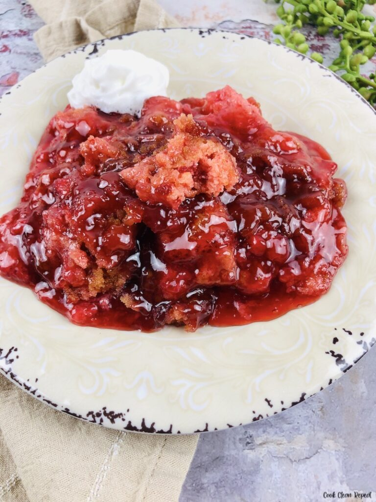 A close up view of a serving of the finished recipe for strawberry dump cake.