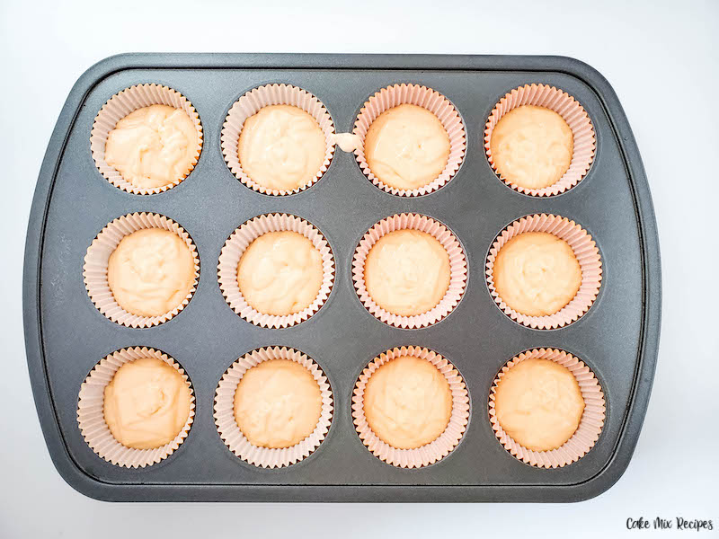 Cupcake batter in the liners ready to be enjoyed.