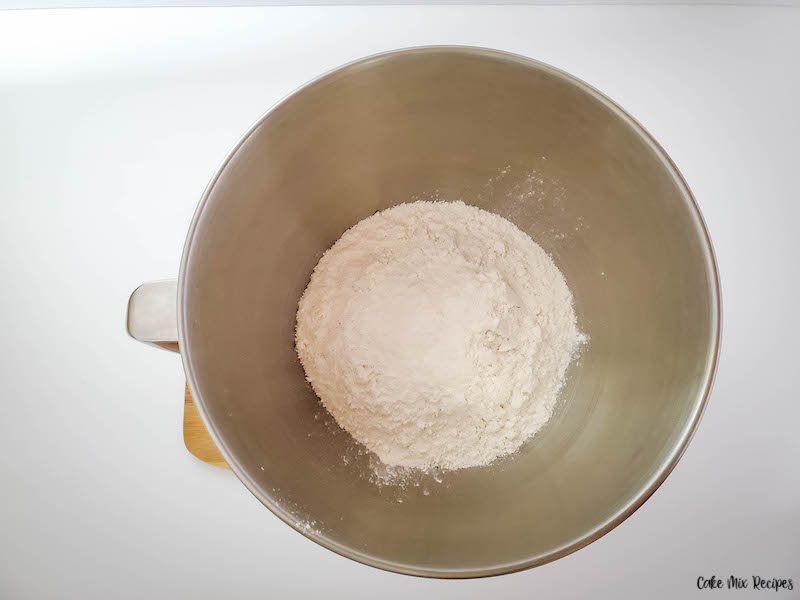 cake mix in the mixer bowl ready to have wet ingredients added.