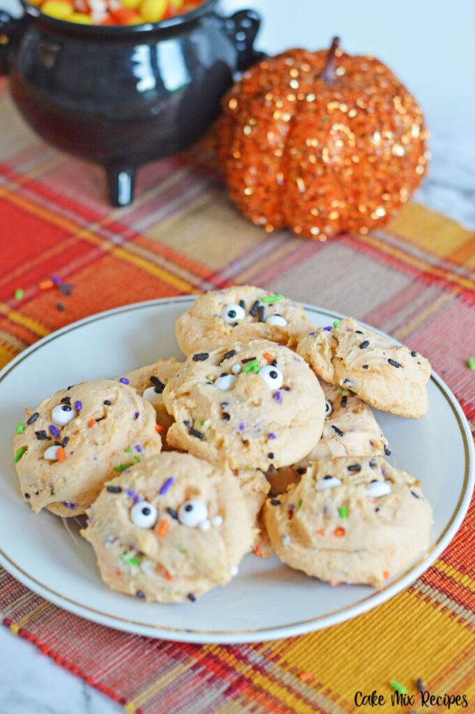 A plate of finished halloween monster cookies with cake mix ready to eat
