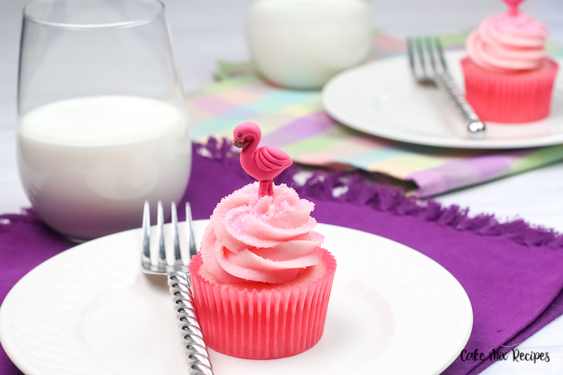 Flamingo being added to finish off the cupcakes.